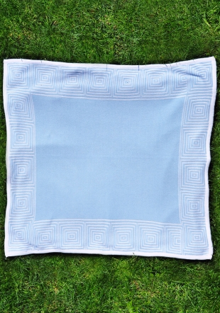 Blue jacquard diaper with a curb