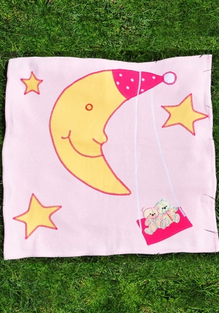 Pink diaper with applique moon, stars and bears